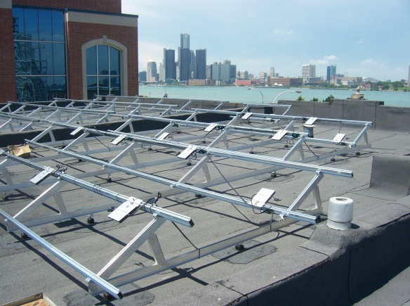Flat roof, angled mounting system, for a 10 kW project on Riverside Drive, Windsor, ON, spectacularly overlooking the Detroit River.