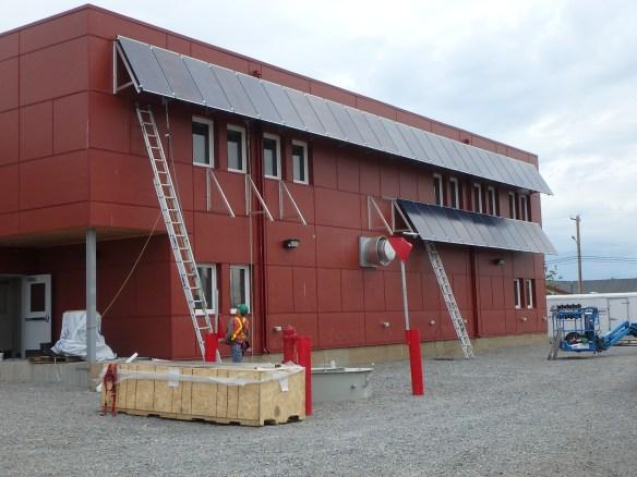Installing our A-frames onto a concrete facade in Behchoko, NWT